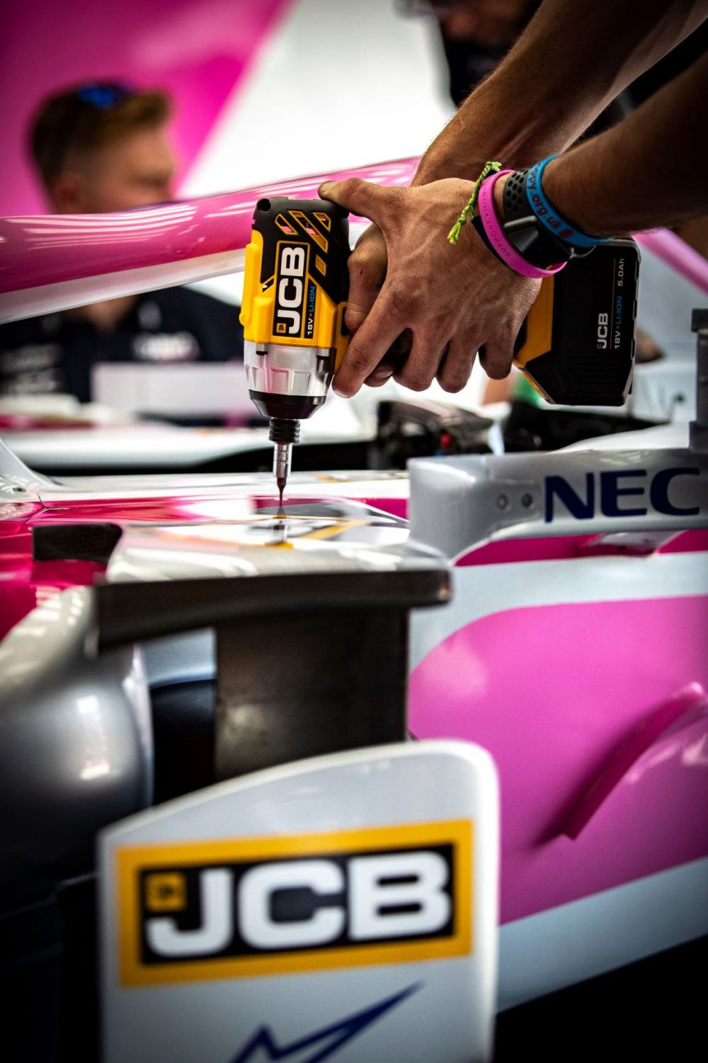 A SportPesa Racing Point F1 team engineer puts the new JCB tools to the test